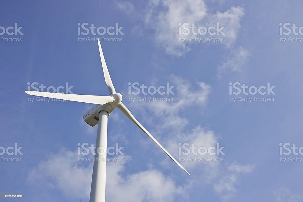 Single windmill for renewable electric energy production royalty-free stock photo