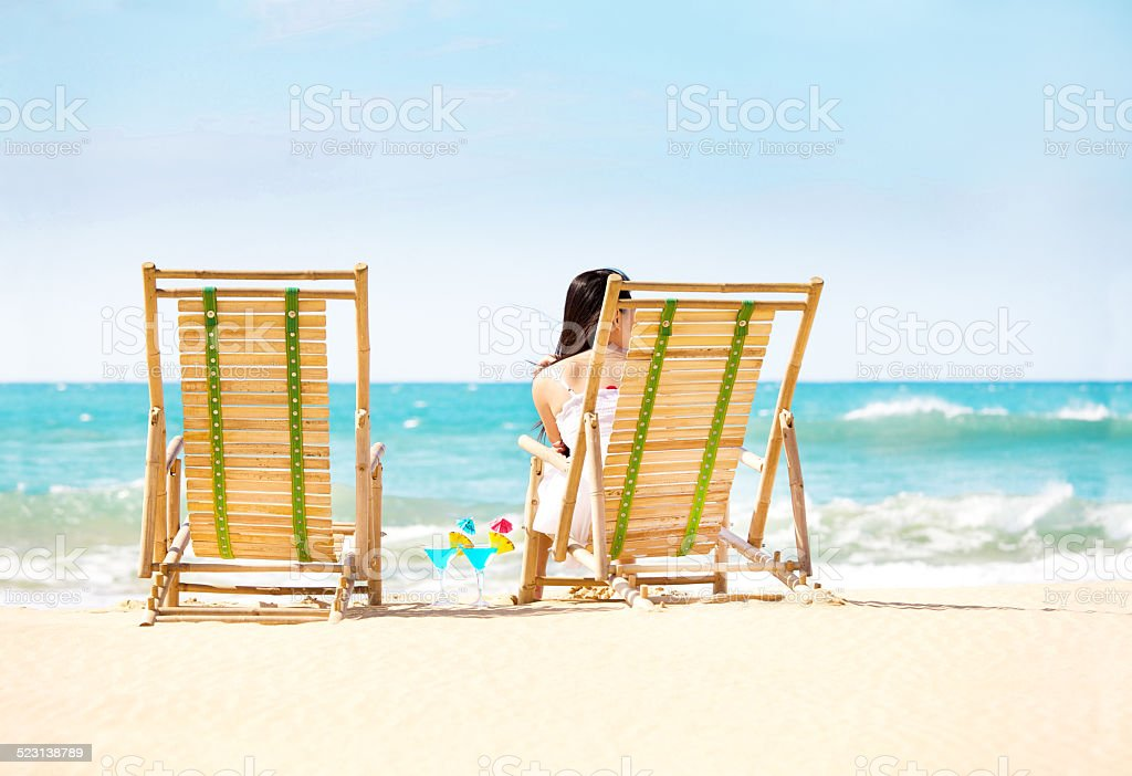 Single Woman on Beach Vacation Waiting for Partner stock photo