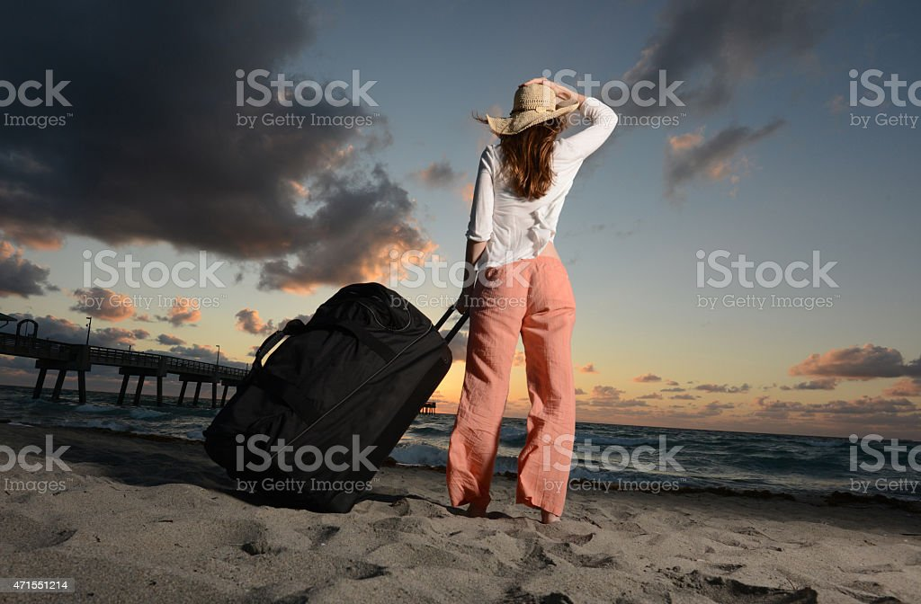 Single woman on vacation at beach stock photo