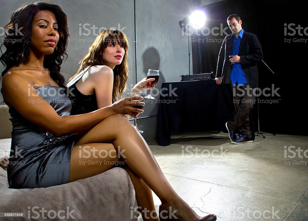 Single Women Seducing Men at a Nightclub stock photo