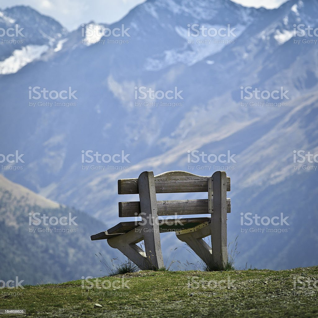 Single Wooden Bench in Mountain stock photo