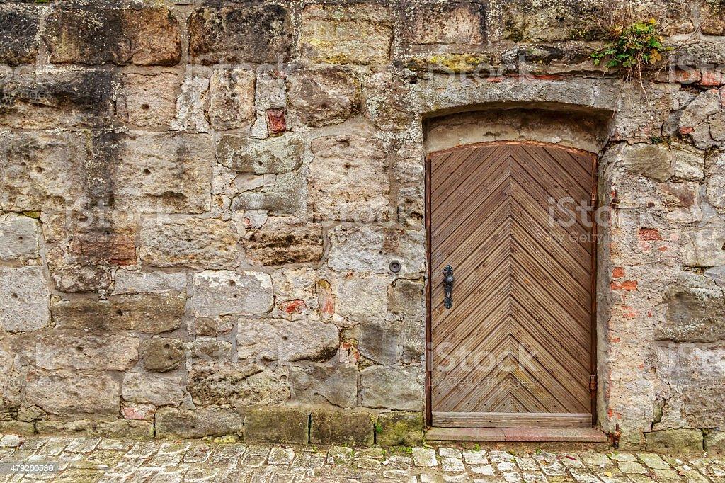 Single Wooden Door in Old City Wall stock photo