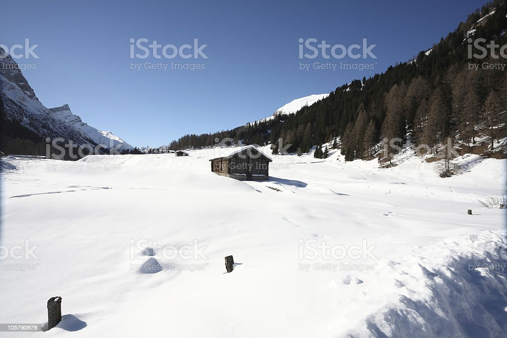 Single Wooden House in the Winter Alps stock photo