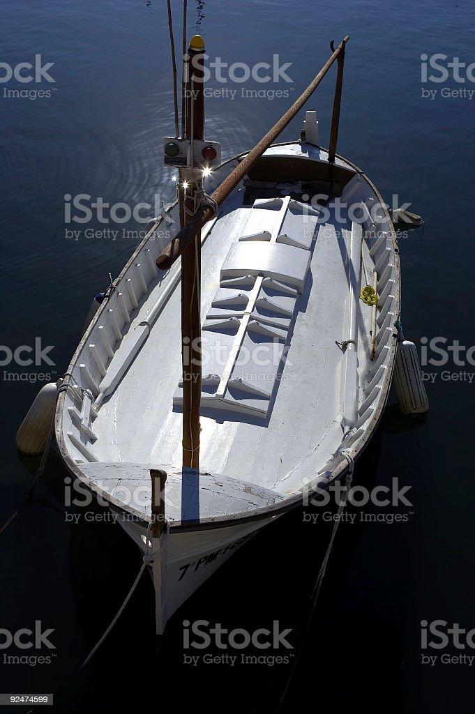 Single wooden white fishing boat royalty-free stock photo