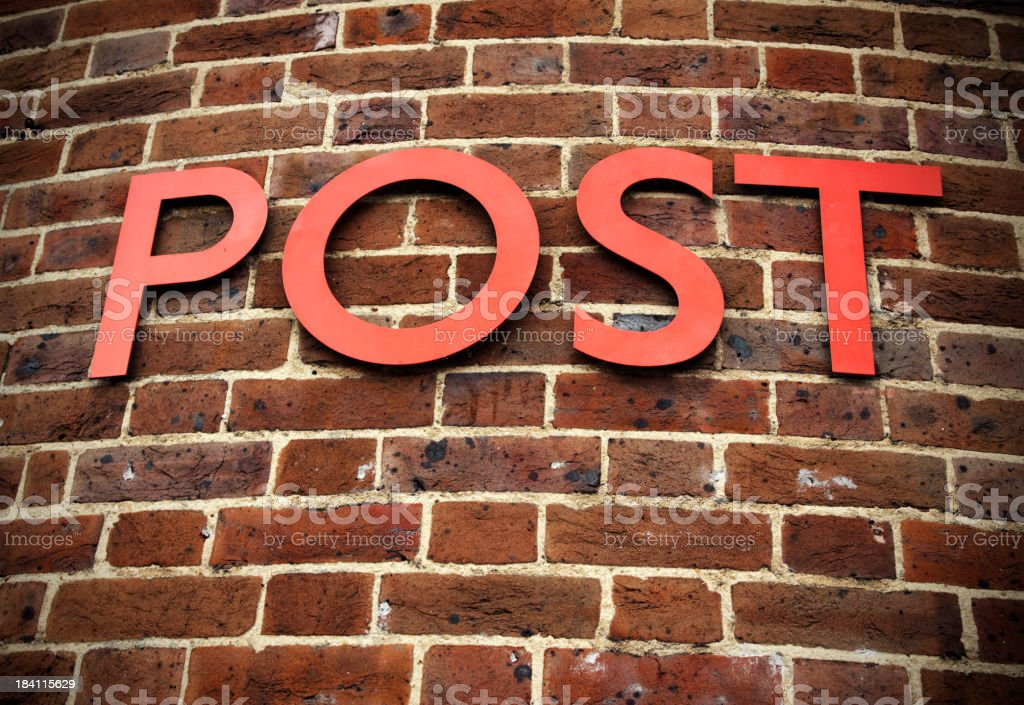 Single word POST on curved brick wall stock photo