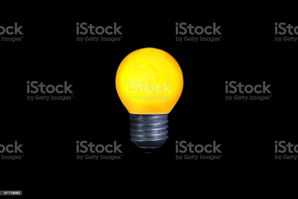 Una bombilla de luz amarilla foto de stock libre de derechos