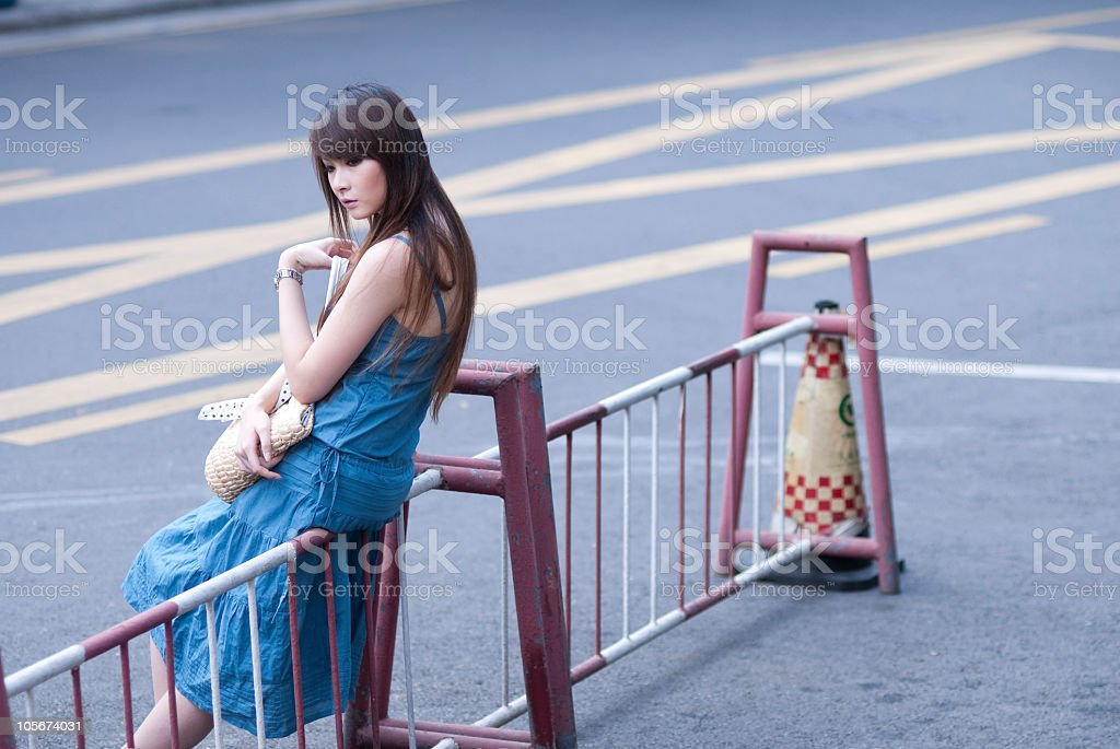single young woman in the street stock photo