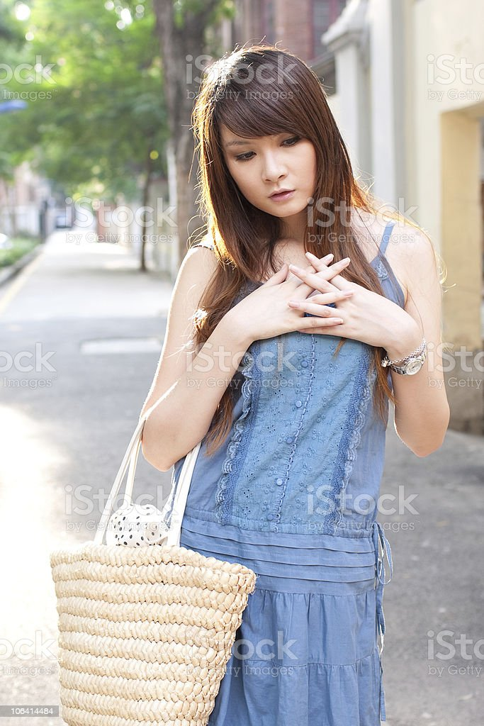 single young woman with bag  in  the street royalty-free stock photo