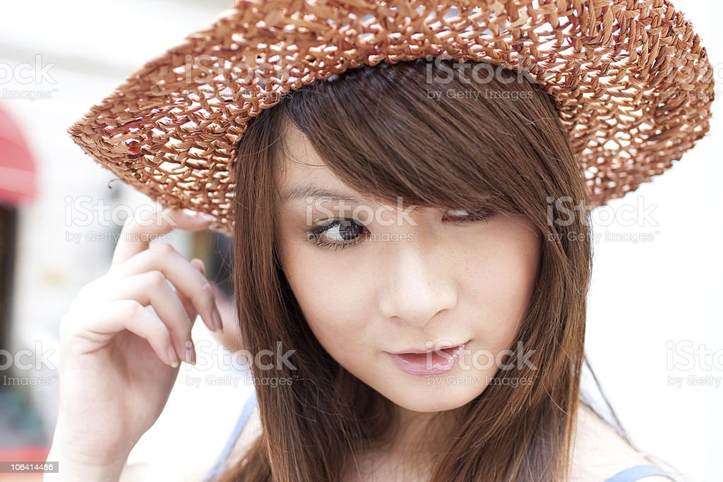 single young woman with hat  in  the street stock photo