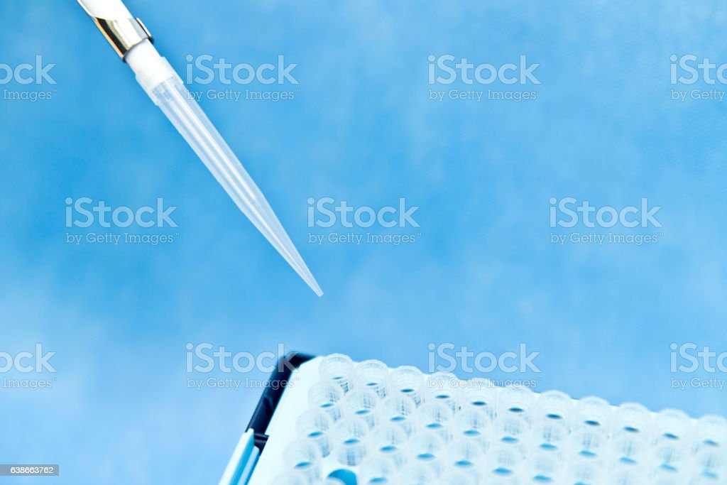 Single-channel manual pipette and steriled tips for research and experiment stock photo