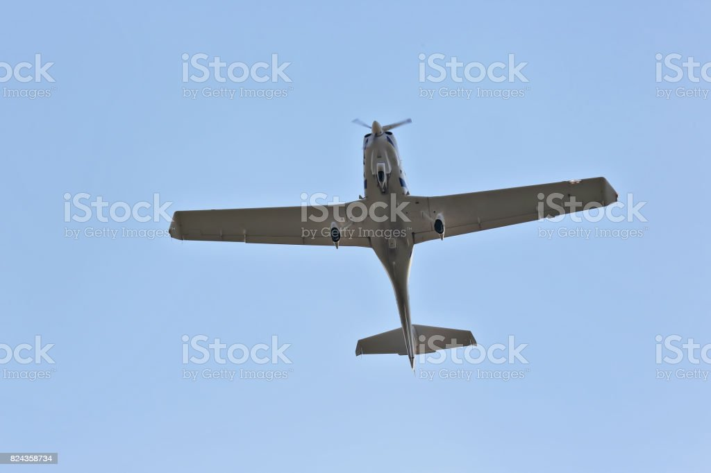 single-engine light aircraft flying in the sky stock photo
