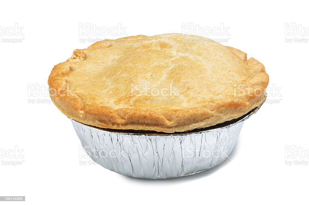 A singular pie in a foil casing stock photo