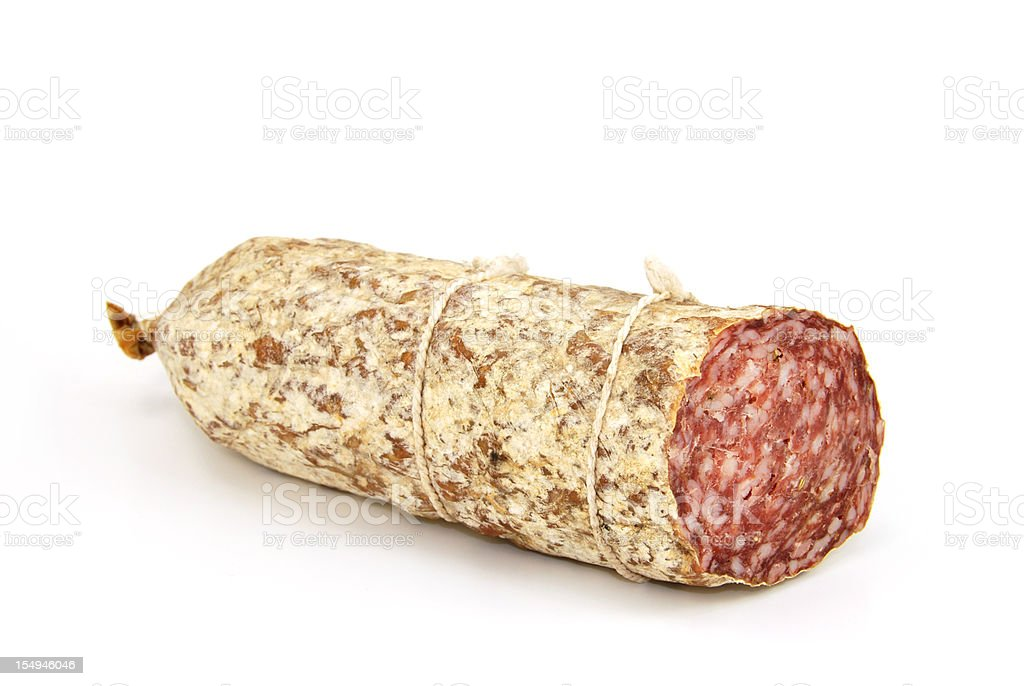 A singular salami sausage on white stock photo