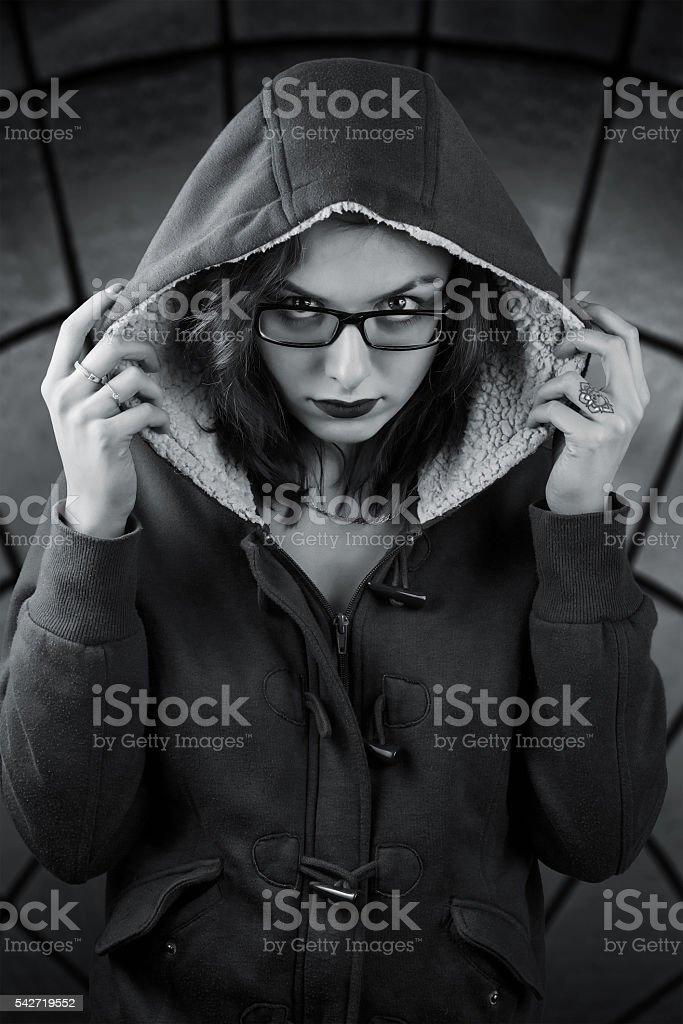 Sinister girl in the hood stock photo