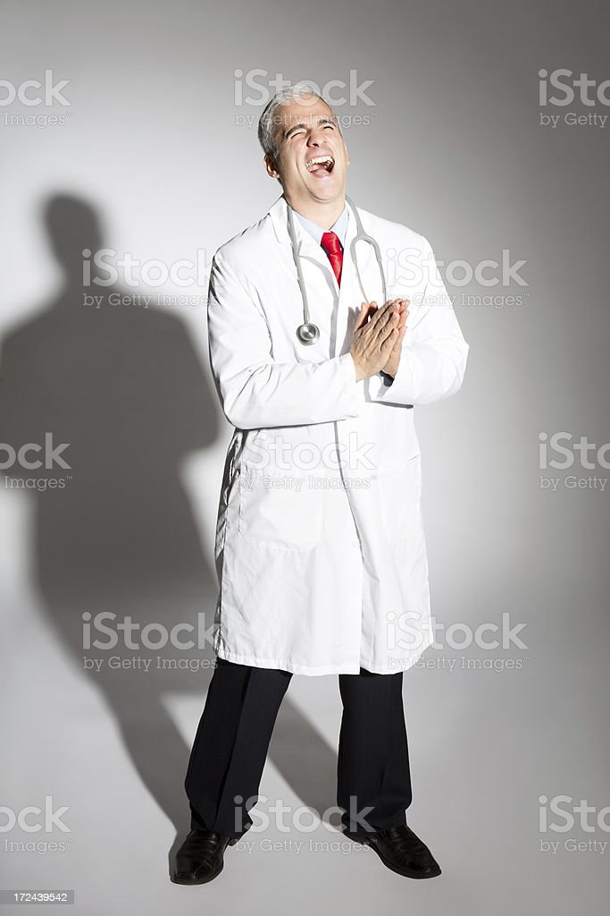 Sinister Mature Doctor Laughing royalty-free stock photo