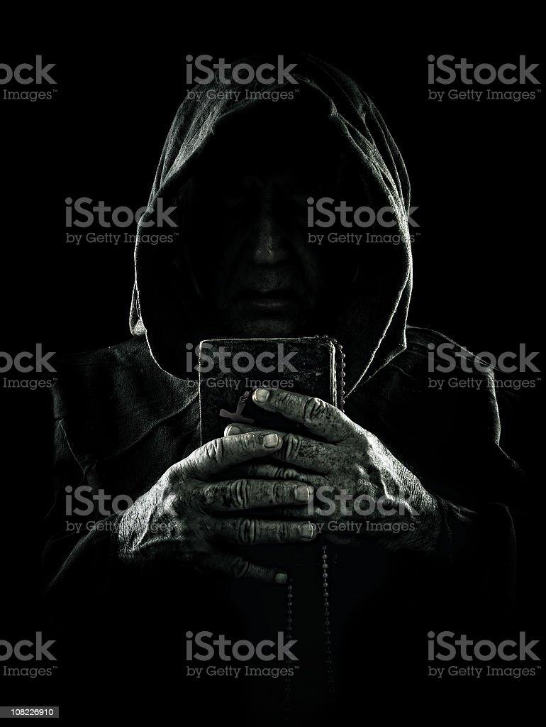 sinister monk stock photo