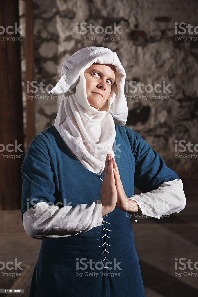 Sinister Nun in Prayer royalty-free stock photo