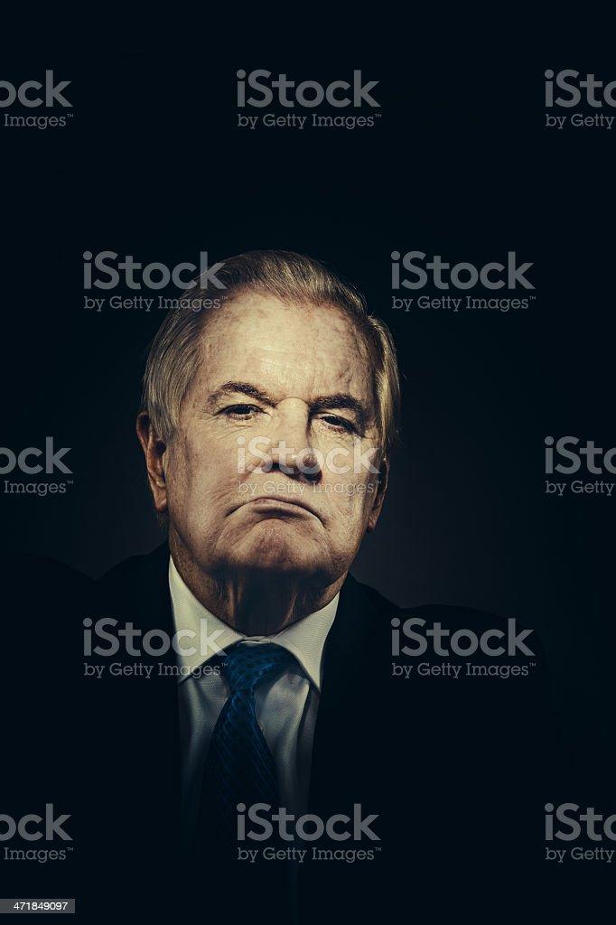 sinister senior businessman stock photo