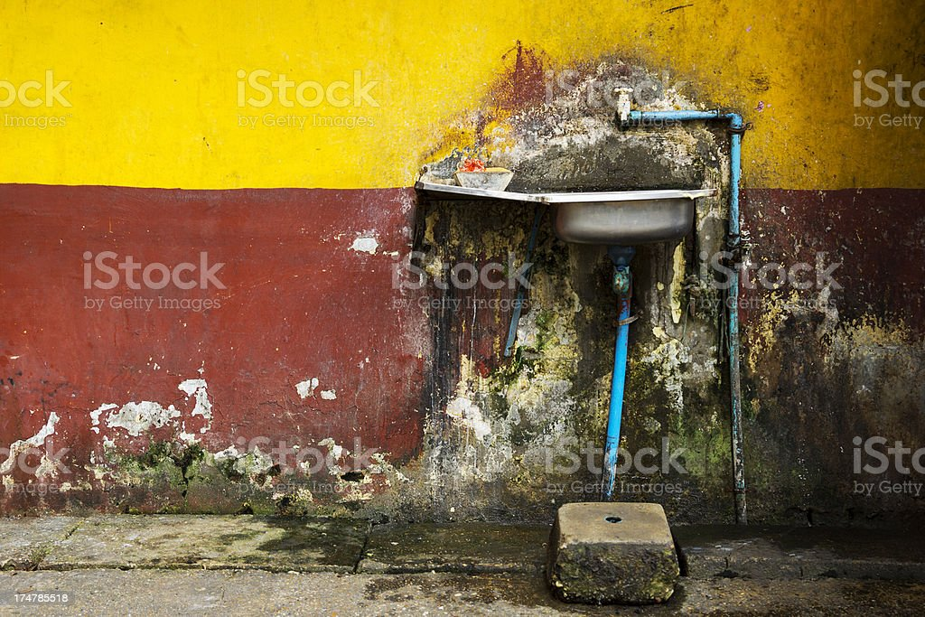 Sink and grunge, multi colored wall royalty-free stock photo