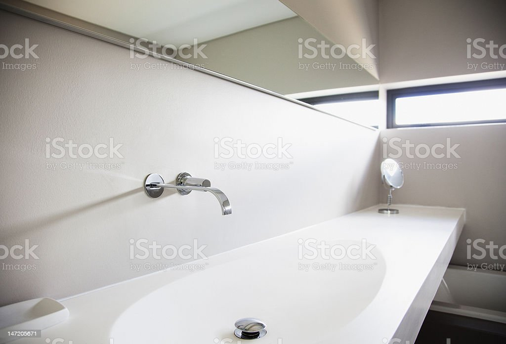 Sink and long mirror in modern bathroom royalty-free stock photo