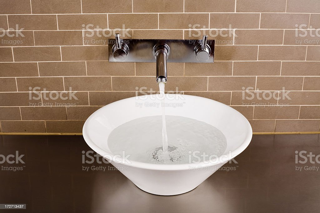 Sink Filling with Running Water royalty-free stock photo