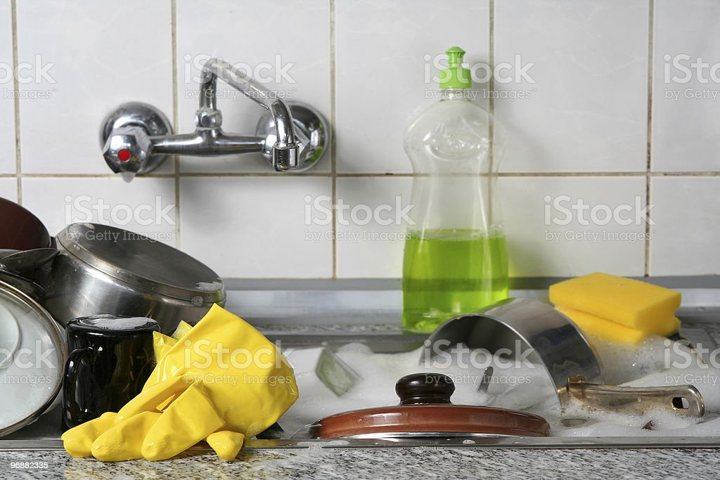 A sink full of dishes waiting to be washed stock photo