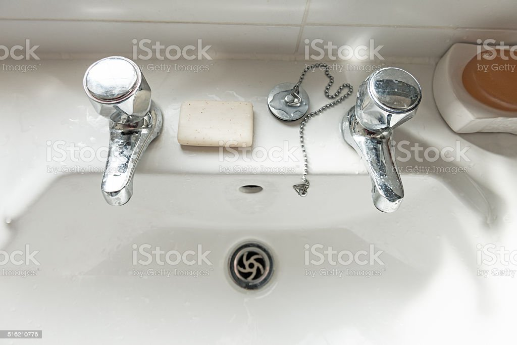 Sink, taps and soap bar stock photo
