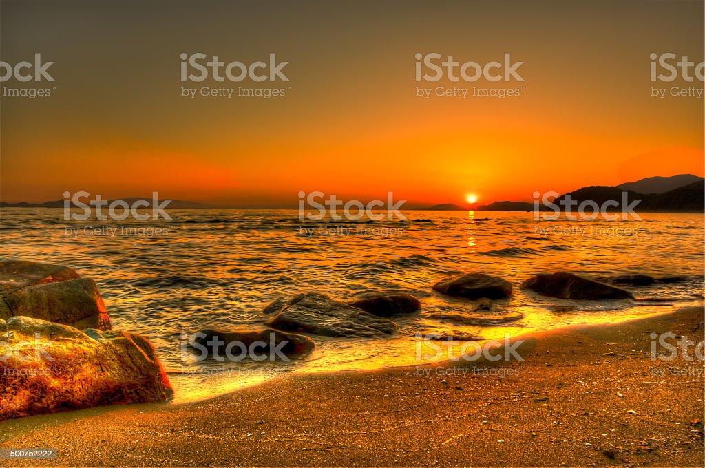 Sink to the coast , the golden sun ( sunset ) stock photo