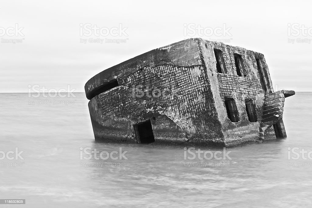 Sinked fortification installation at the old destroyed stock photo