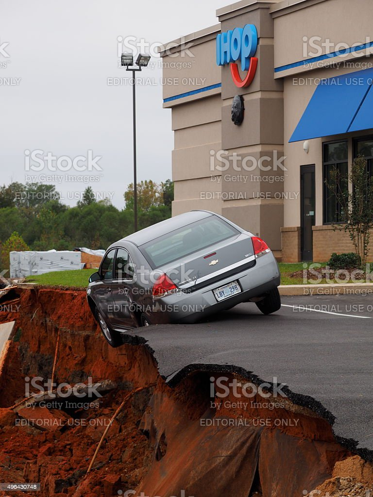 Sinkhole and Teetering Car at the Meridian Mississippi IHop Restaurant stock photo