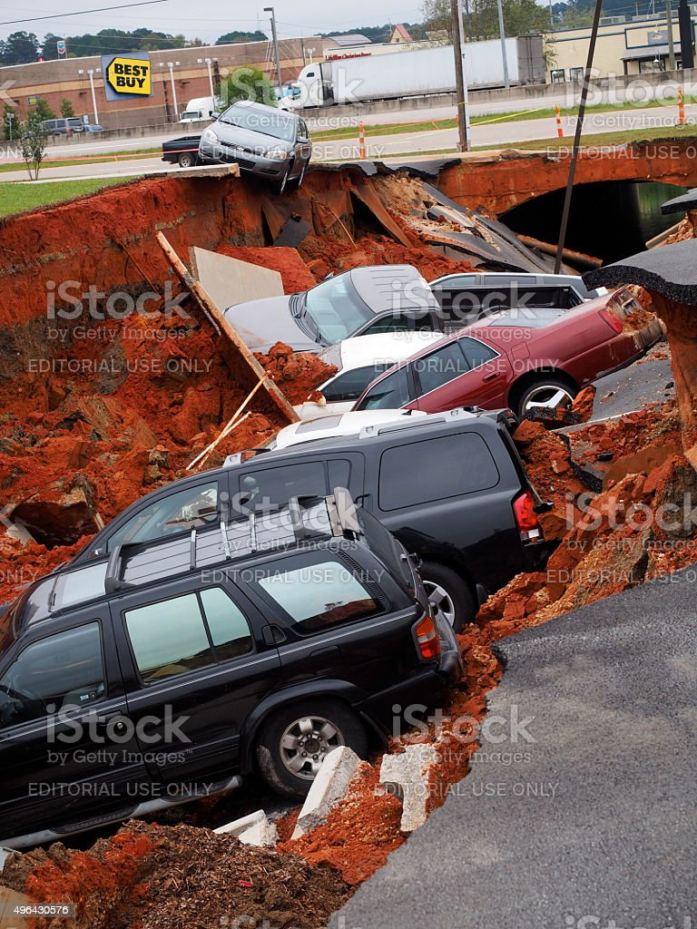 Sinkhole at Meridian Mississippi I Hop restaurant swallows cars stock photo