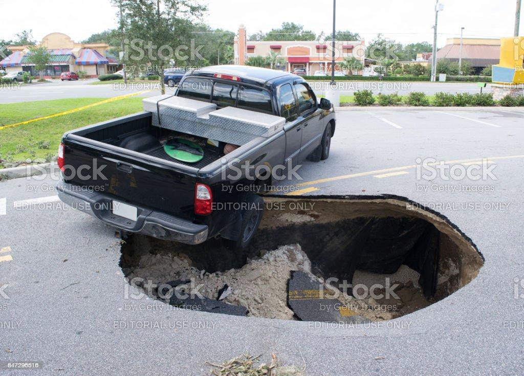 Sinkhole Swallows a Car in Florida stock photo