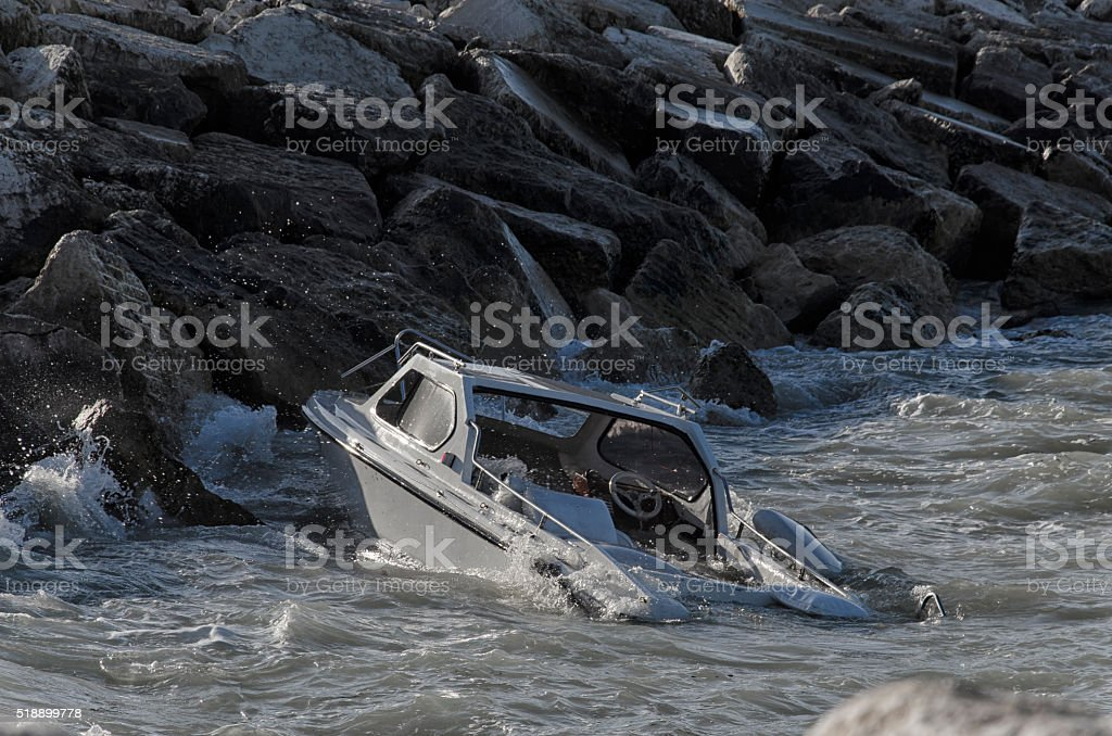 Sinking boat in front of the port stock photo