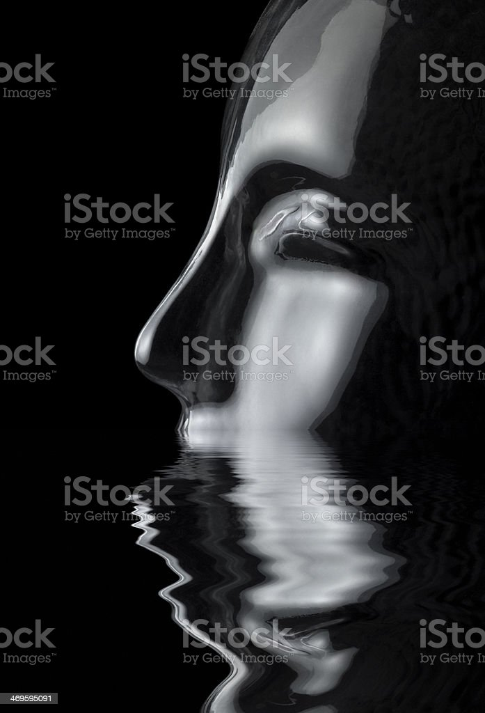 sinking glass head stock photo