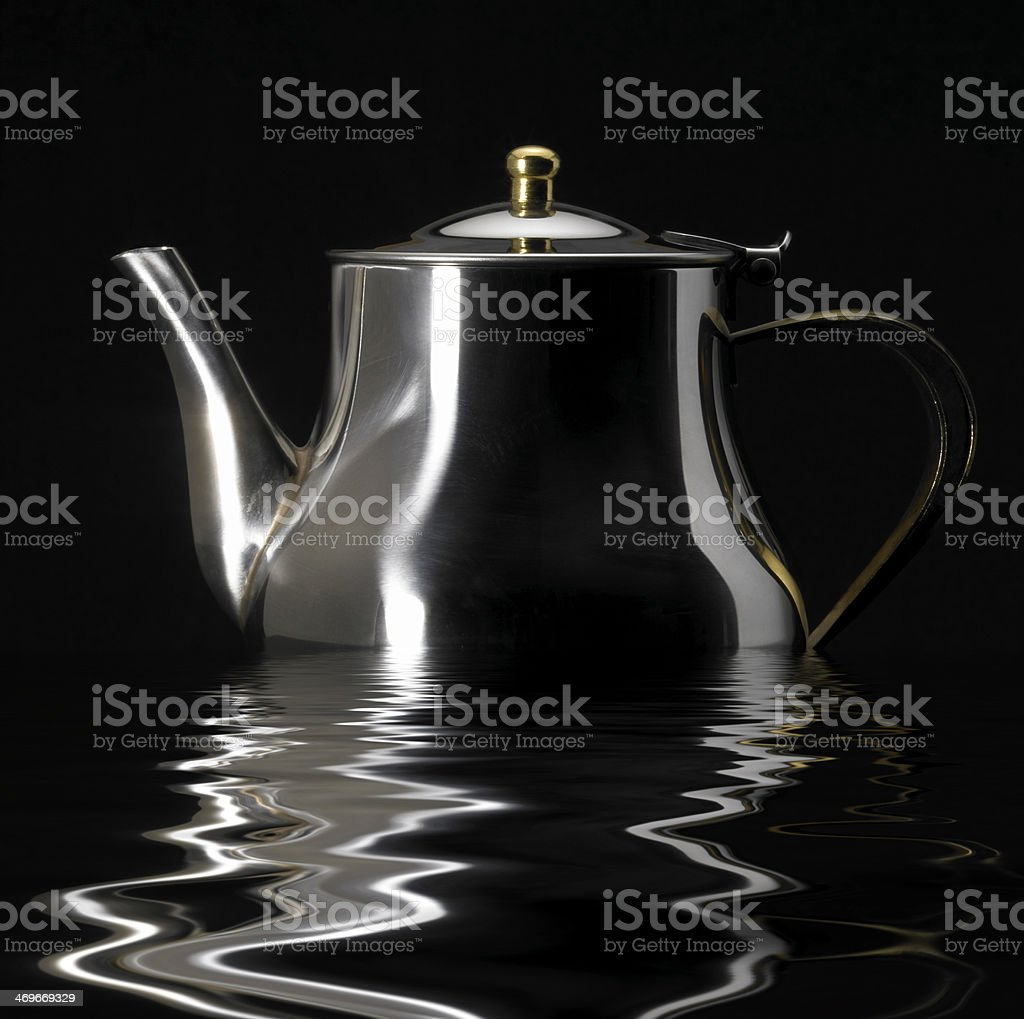 sinking metallic tea pot stock photo