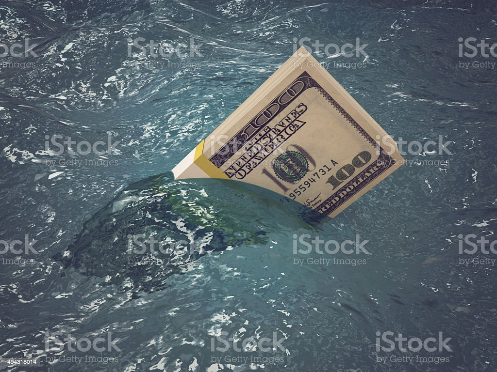 Sinking money - finance crisis stock photo