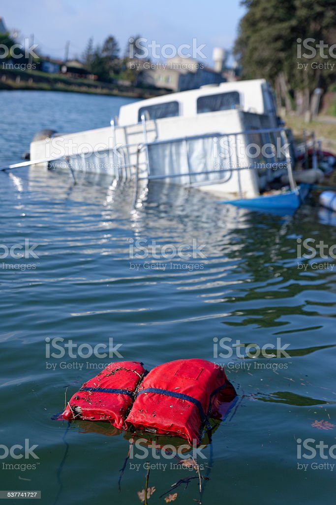 sinking ship after a storm stock photo