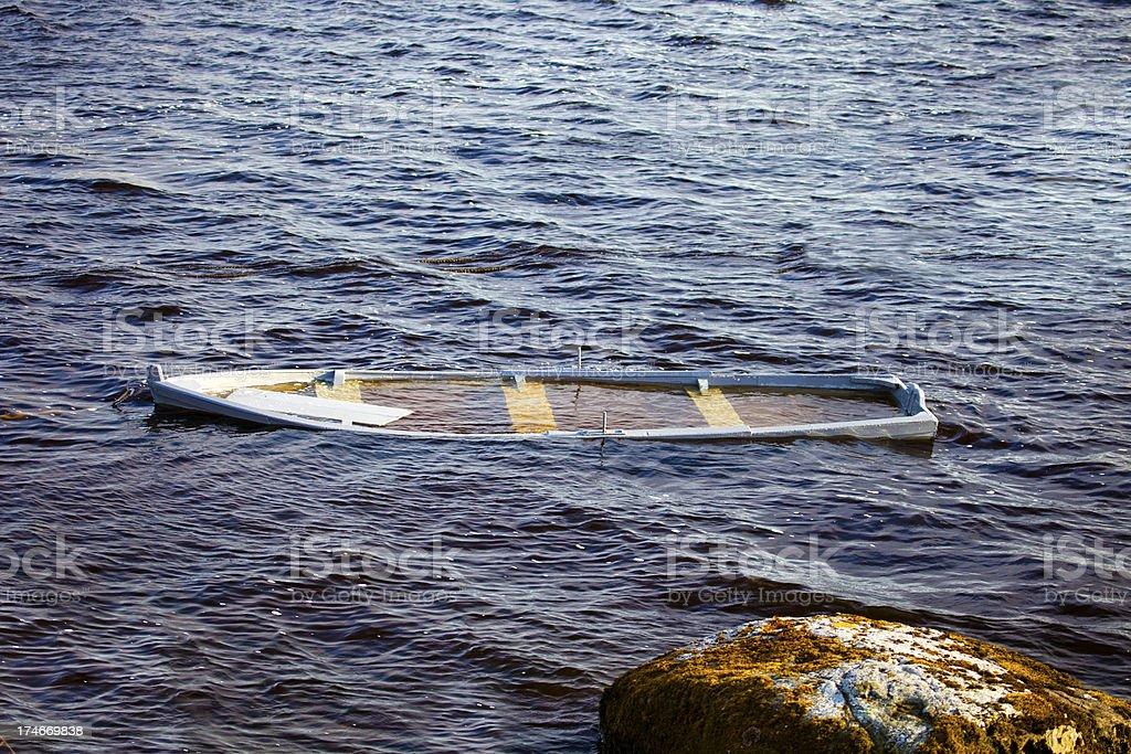 Sinking skiff royalty-free stock photo
