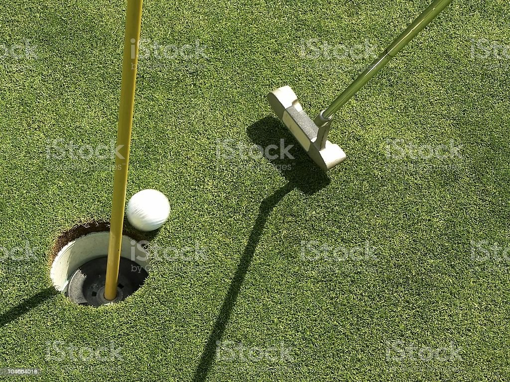 Sinking the Golf Putt royalty-free stock photo