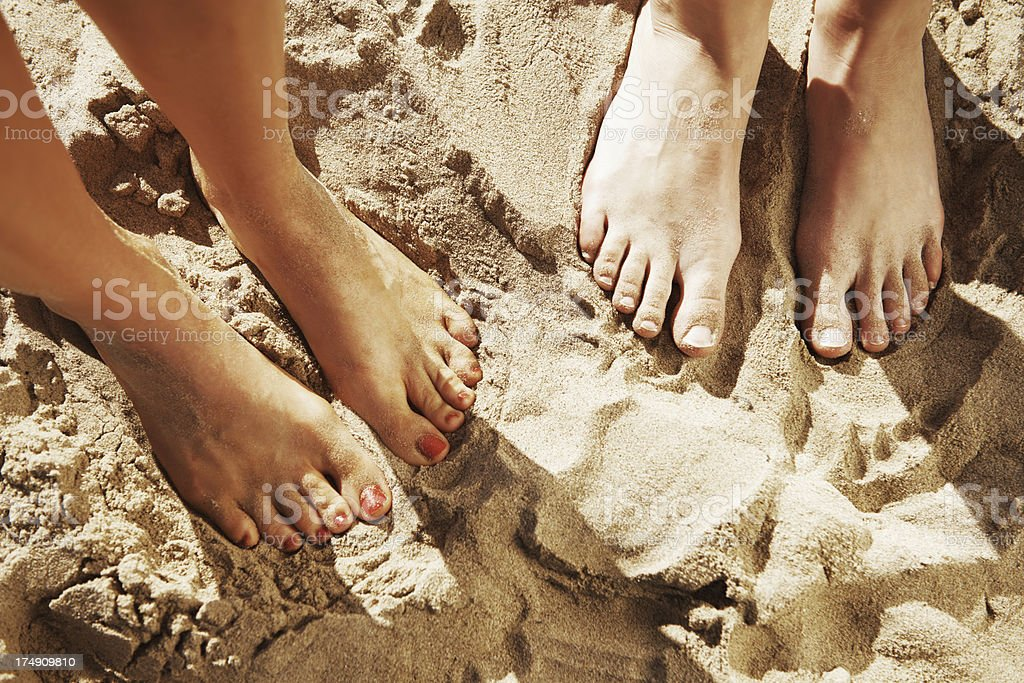 Sinking their toes in the warm sand royalty-free stock photo
