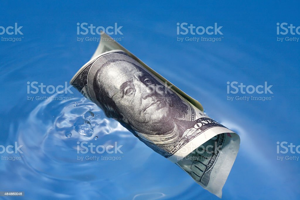 Sinking USA Currency stock photo