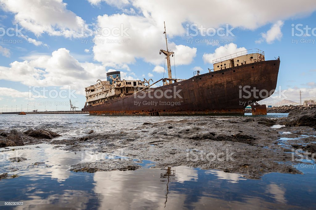 Sinking wreck of an old frighter stock photo