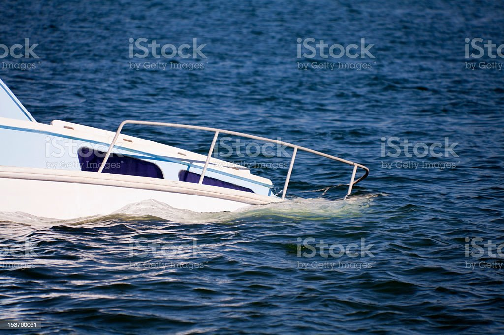 Sinking yacht bow in beautiful ocean water stock photo