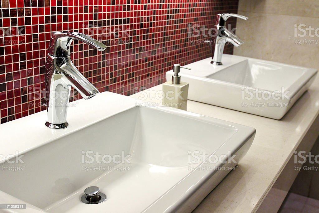sinks and taps in toilet royalty-free stock photo