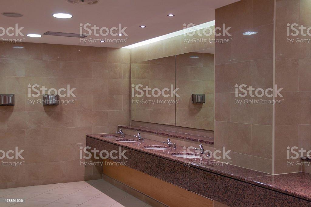 sinks in a public toilet stock photo