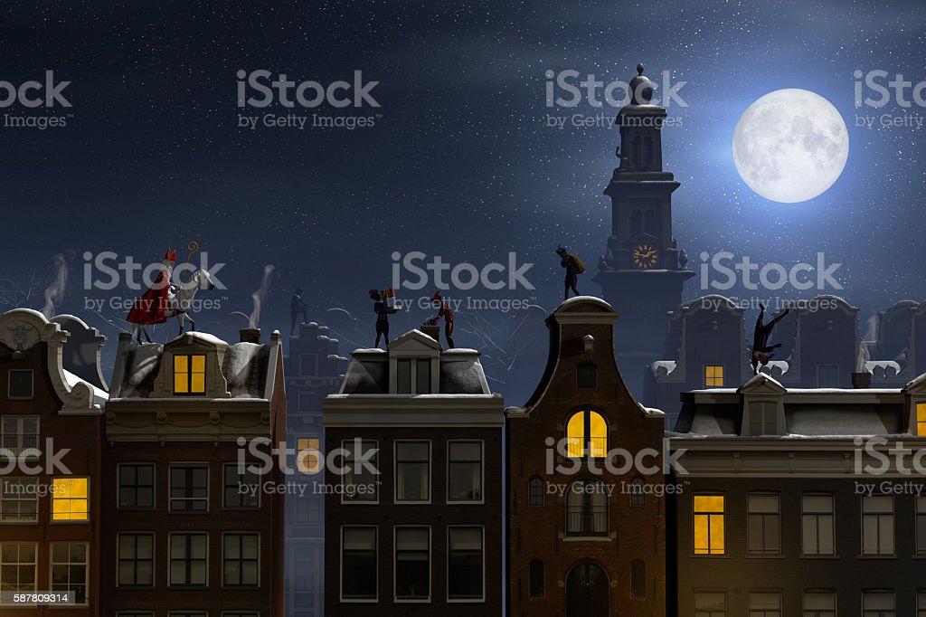 Sinterklaas and the Pieten on the rooftops at night stock photo