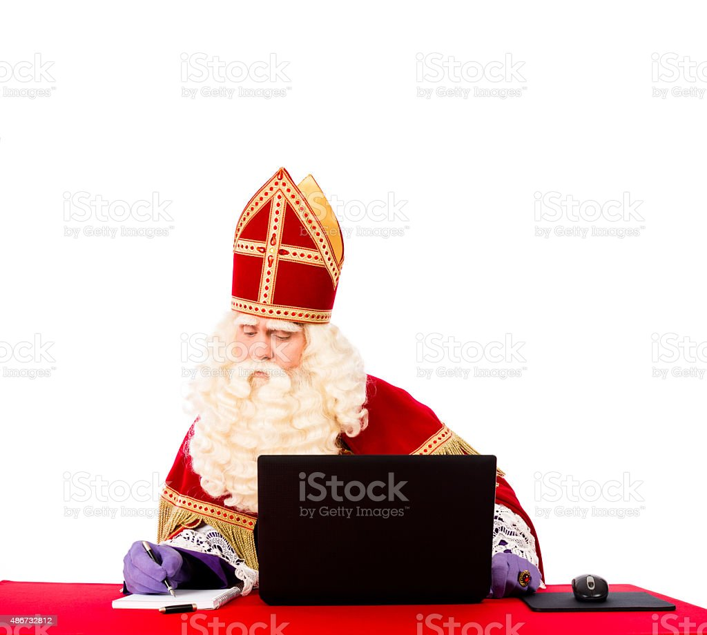 Sinterklaas with laptop stock photo