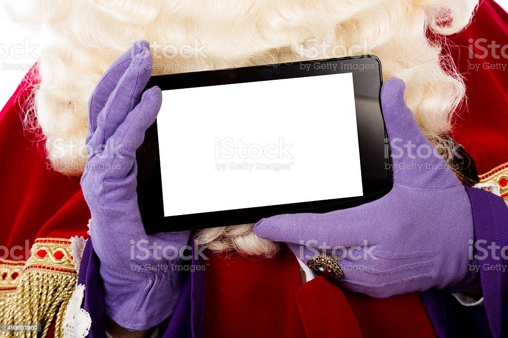 Sinterklaas with tablet stock photo