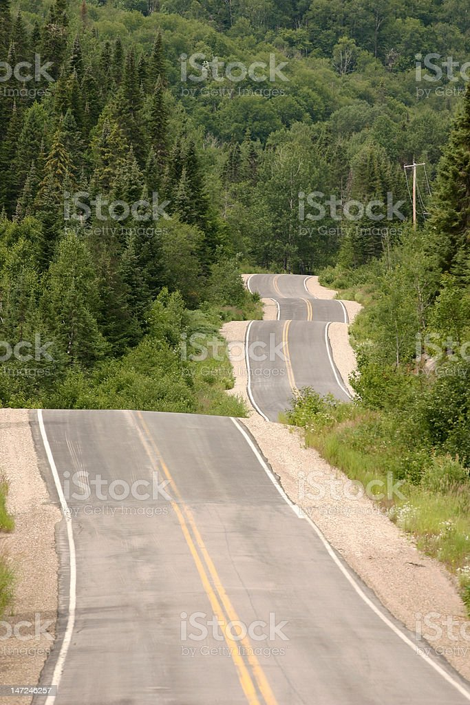 Sinuous and damaged road royalty-free stock photo