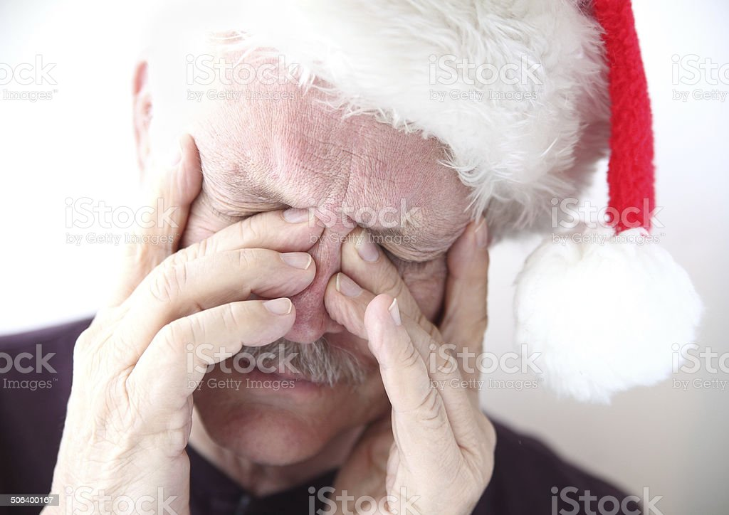 sinus pain in man with Santa hat stock photo